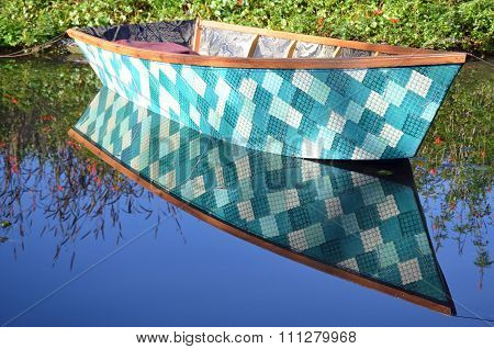Teal checkered row boat