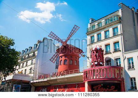 Paris - JULY 8, 2013:  Moulin Rouge Cabaret famous red mill on July 8 in Paris, France. Moulin Rouge Cabaret is the famous cabaret theatre in Paris since 1889