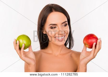 Good-looking Bonny Girl Chosing Between Green And Red Apples