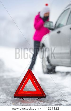 warning triangle with winter car breakdown