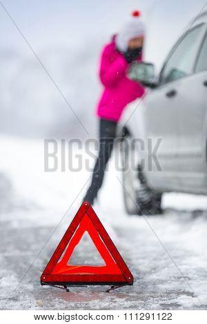 warning triangle with winter car breakdown