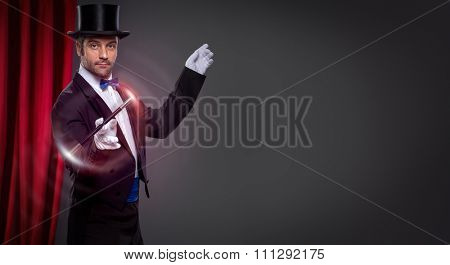 Magician with  magic wand in action