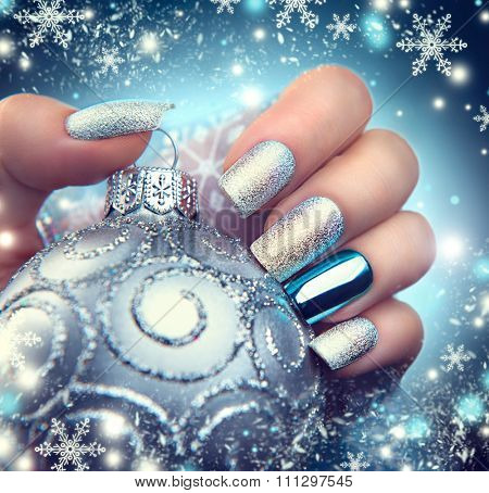 Christmas Nail art manicure. Winter Holiday style bright Manicure Design. Christmas decorations and snowflakes. Nail Polish. Beauty hands. Trendy Stylish Silver and Blue Colorful Nails, Nailpolish