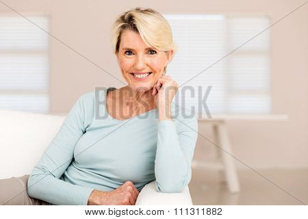pretty mid age woman relaxing at home