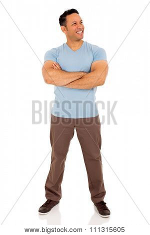 happy mid age man with arms folded looking away