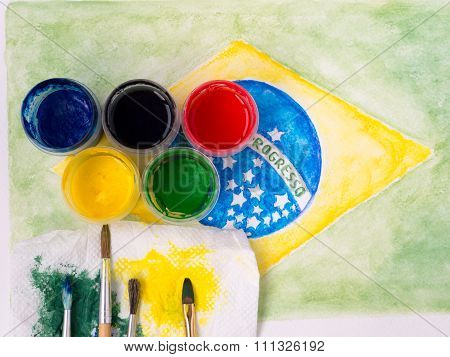 Paints,brushes And And Stained Fabric On The Brazil Flag Watercolor Painting