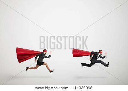 superman and superwoman fast running over light grey background