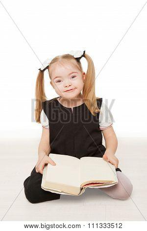 Preschooler Girl Reading A Book.