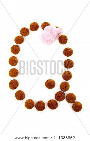 Ginger Nuts, Pepernoten, In The Shape Of Letter Q Isolated On White Background