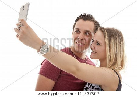 Young Couple Making Selfie Over White Background