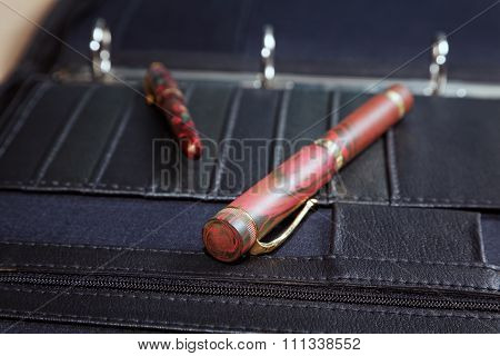 Business Still-life With Pens And A Leather Folder
