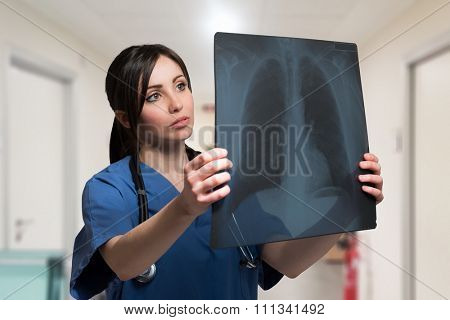 Nurse looking at a lung radiography