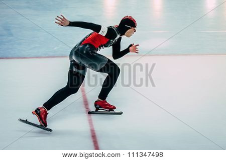 closeup side view of female athlete running track speed skater