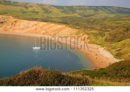 Mild late autumn weather attracted visitors to the beach at Worbarrow Bay,  Dorset, England, UK