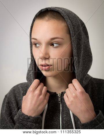 Beautiful Young Teenager With Shaven Head And Wearing A Hoodie