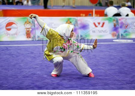 JAKARTA, INDONESIA - NOVEMBER 17, 2015: Elif Akyuz of Turkey performs the movements in the women's Compulsory Changquan event at the 13th World Wushu Championship 2015 at the Istora Senayan Stadium.