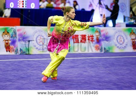 JAKARTA, INDONESIA - NOVEMBER 17, 2015: Liudmyla Temna of Ukraine performs the movements in the women's Compulsory Changquan event at the 13th World Wushu Championship 2015 in Istora Senayan Stadium.