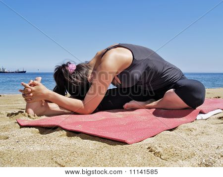 Bikram Yoga Janushirasana Pose At Beach