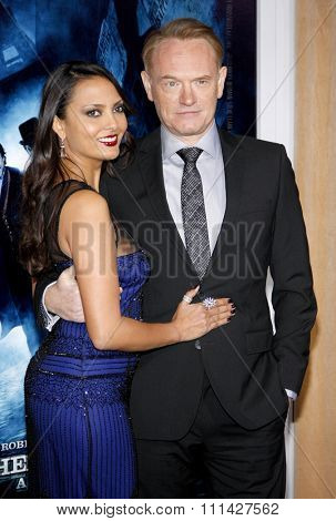 December 6, 2011. Allegra Riggio and Jared Harris at the Los Angeles premiere of