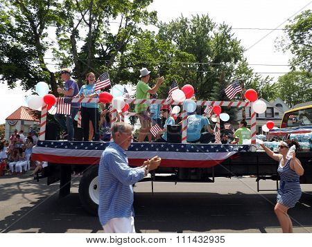 Young Americans Riding a Truck in the 4th of July Parade