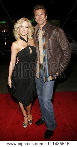Lorenzo Lamas and Barbara Moore attend the Warner Bros World Premiere of