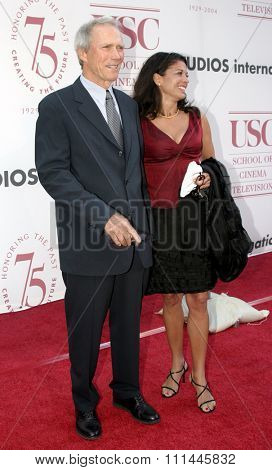 Clint Eastwood and Dina Ruiz at the 75th Diamond Jubilee Celebration for the USC School of Cinema-Television held at the USC's Bovard Auditorium in Los Angeles, United States on September 26 2004.