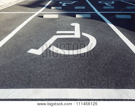 Wheelchair Handicap Sign At Parking Lot