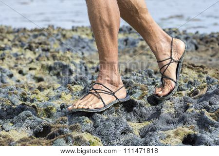 Walking In Sandals On Coral Reef