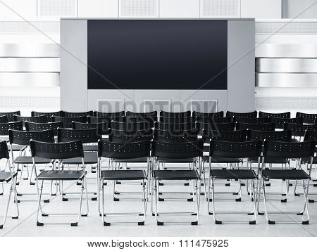 Business Meeting Seminar Room Conference With Seats And Blank Screen Display