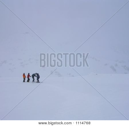 Four Skiers In The Backcountry.