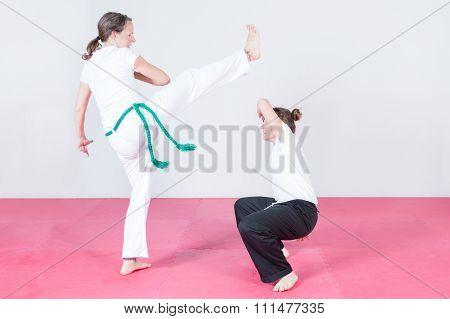 Two Women Dancing Capoeira