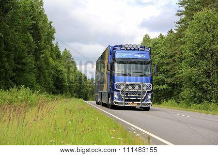 Blue Volvo FH Flower Transport Truck On Summer Road