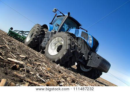 Modern Tractor Working In The Field
