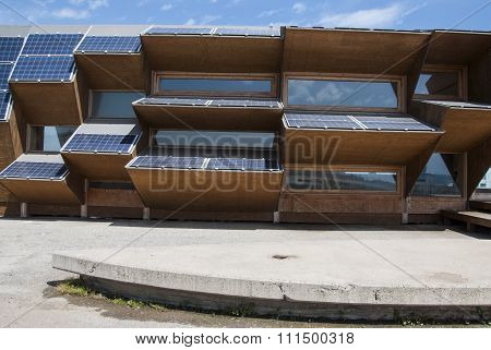 Public building made of solar panels wood and mirror glass in Barcelona