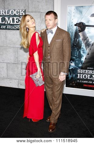 Jacqui Ainsley and Guy Ritchie at the Los Angeles premiere of 'Sherlock Holmes: A Game Of Shadows' held at the Regency Village Theatre in Westwood on November 6, 2011.
