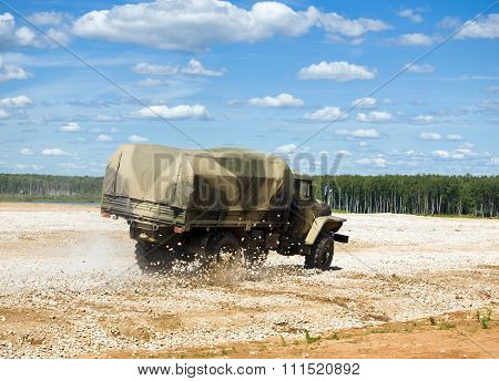 Military truck Ural 4320 in a controlled drift