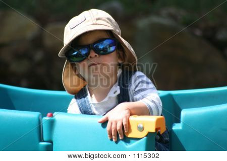 Boy With Sunglasses At Open Wagon Door