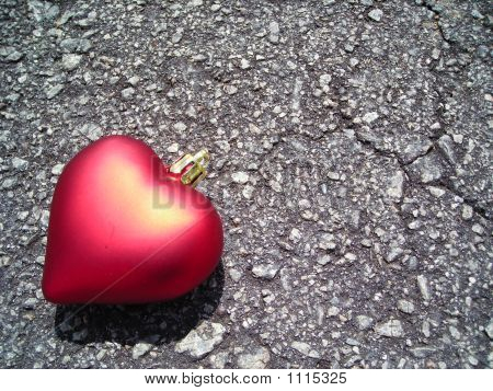 Single Red Heart Against Bituman Background