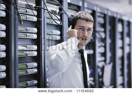 It Engeneer Talking By Phone At Network Room