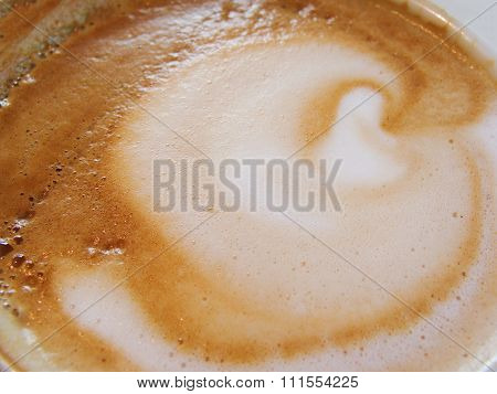 White Cup with a gourmet coffee and foam figure