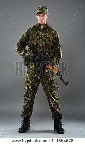 Soldier In Uniform With Machine Gun