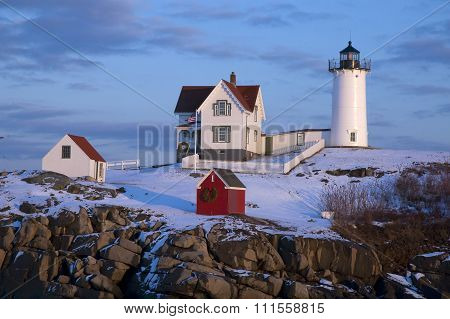 Snow Covered Lighthouse In Maine During Holidays