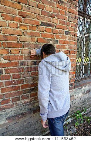 Sad Man By The Wall