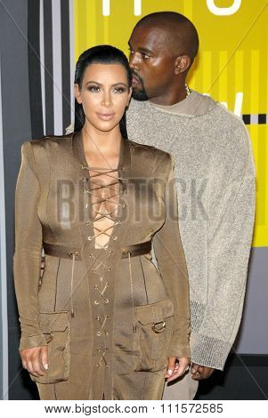 LOS ANGELES, CA - AUGUST 30, 2015: Kim Kardashian and Kanye West at the 2015 MTV Video Music Awards held at the Microsoft Theater in Los Angeles, USA on August 30, 2015.