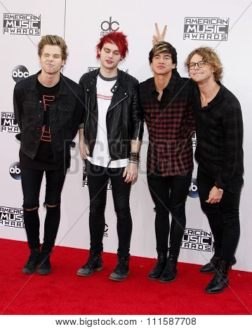 LOS ANGELES, CA - NOVEMBER 23, 2014: Luke Hemmings, Michael Clifford, Calum Hood and Ashton Irwin of 5 Seconds of Summer at the 2014 American Music Awards held at the Nokia Theatre L.A. Live.