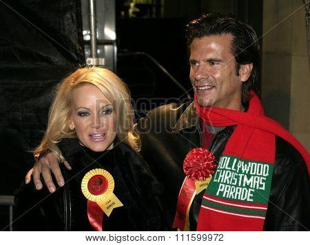 Barbara Moore and Lorenzo Lamas at the 73rd Annual Hollywood Christmas Parade held at the Hollywood Roosevelt Hotel in Hollywood, USA on November 28, 2004.