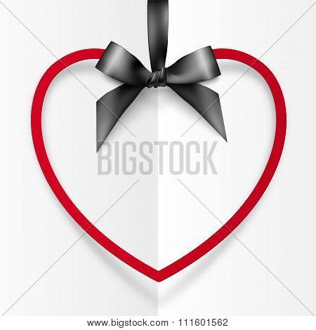 Red heart shape frame hanging on silky black ribbon with bow