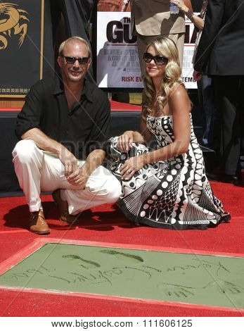 09/06/2006 - Hollywood - Kevin Costner and Christine Baumgartner at the Kevin Costner Hand and Footprints Ceremony held at the Grauman's Chinese Theater in Hollywood, California, United States.