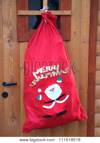 Red Sack Of Gifts Of Santa Claus For The Children At Christmas