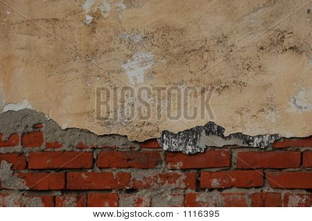 Red Brick And Old Yellow Plaster